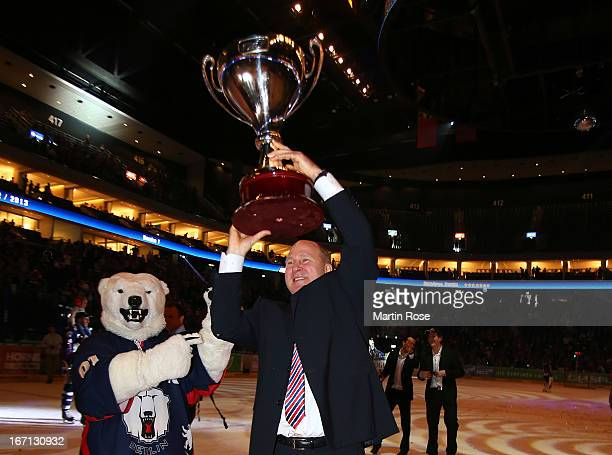 Don Jackson head coach of Berlin lifts the trophy after winning in game four of the DEL final playoffs between Eisbaeren Berlin and Koelner Haie at...