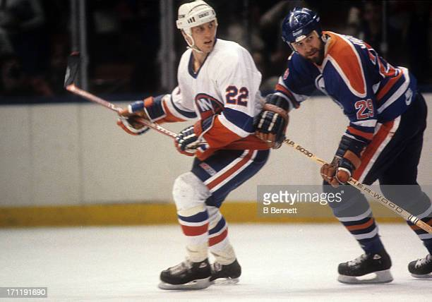 Don Jackson of the Edmonton Oilers follows Mike Bossy of the New York Islanders during the 1984 Stanley Cup Finals in May 1984 at the Nassau Coliseum...