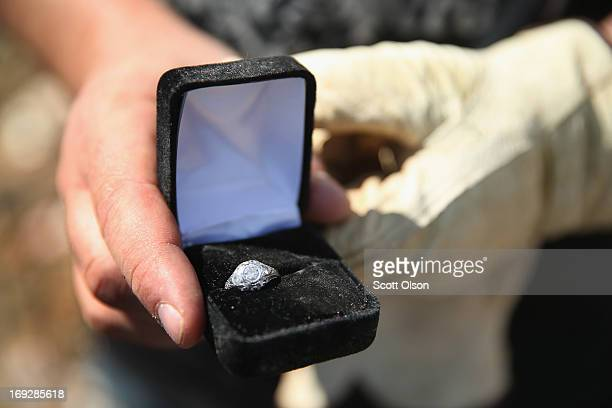 Don Jackson shows his wife's wedding ring after he found it in the rubble of his home that was destroyed by a tornado that ripped through the area on...