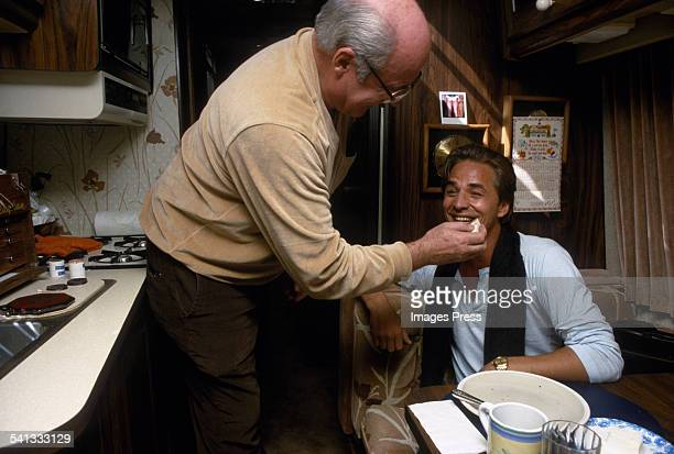Don Johnson gets makeup put on by Vince Callaghan prior to filming an episode of Miami Vice circa 1985 in Miami Florida