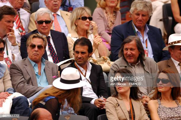 Don Johnson watches the action with Ilie Nastase