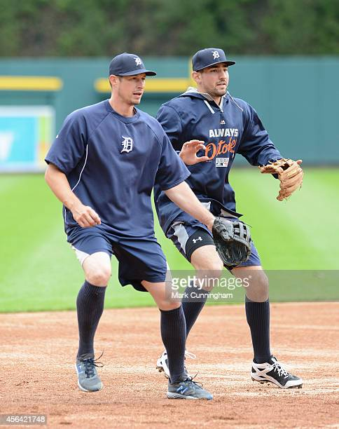 Don Kelly and Nick Castellanos of the Detroit Tigers stand together on the field during the American League Division Series Workout Day at Comerica...