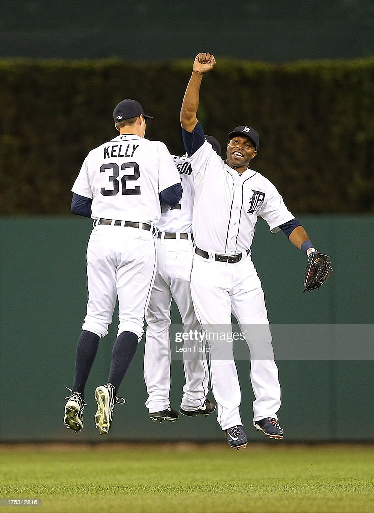 Don Kelly #32, <a gi-track='captionPersonalityLinkClicked' href=/galleries/search?phrase=Austin+Jackson&family=editorial&specificpeople=608633 ng-click='$event.stopPropagation()'>Austin Jackson</a> #14 and <a gi-track='captionPersonalityLinkClicked' href=/galleries/search?phrase=Torii+Hunter&family=editorial&specificpeople=183408 ng-click='$event.stopPropagation()'>Torii Hunter</a> #48 of the Detroit Tigers celebrate a win over the Chicago White Sox at Comerica Park on August 2, 2013 in Detroit, Michigan. The Tigers defeated the White Sox 2-1.