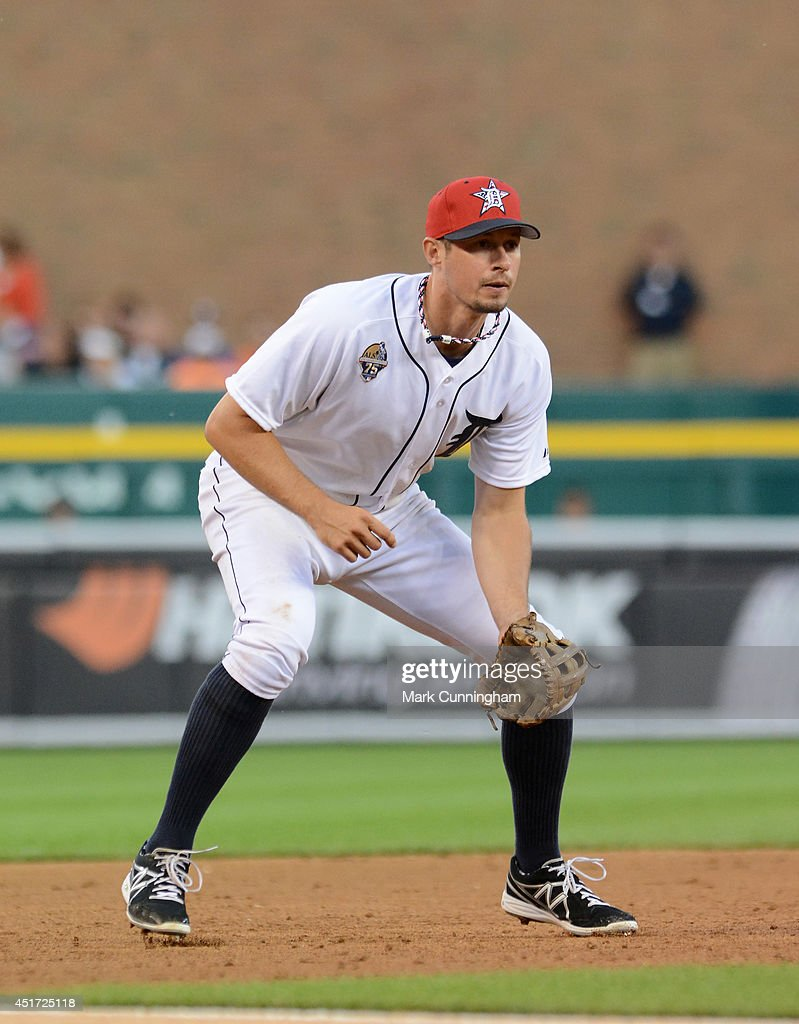 Don Kelly #32 of the Detroit Tigers fields while wearing a special red, white and blue hat to honor Independence Day during the game against the Tampa Bay Rays at Comerica Park on July 4, 2014 in Detroit, Michigan. The Rays defeated the Tigers 6-3.