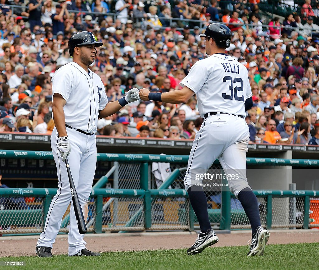 Don Kelly #32 of the Detroit Tigers is congratulated by <a gi-track='captionPersonalityLinkClicked' href=/galleries/search?phrase=Jhonny+Peralta&family=editorial&specificpeople=213286 ng-click='$event.stopPropagation()'>Jhonny Peralta</a> #27 after scoring a run in the sixth inning while playing the Philadelphia Phillies at Comerica Park on July 28, 2013 in Detroit, Michigan.