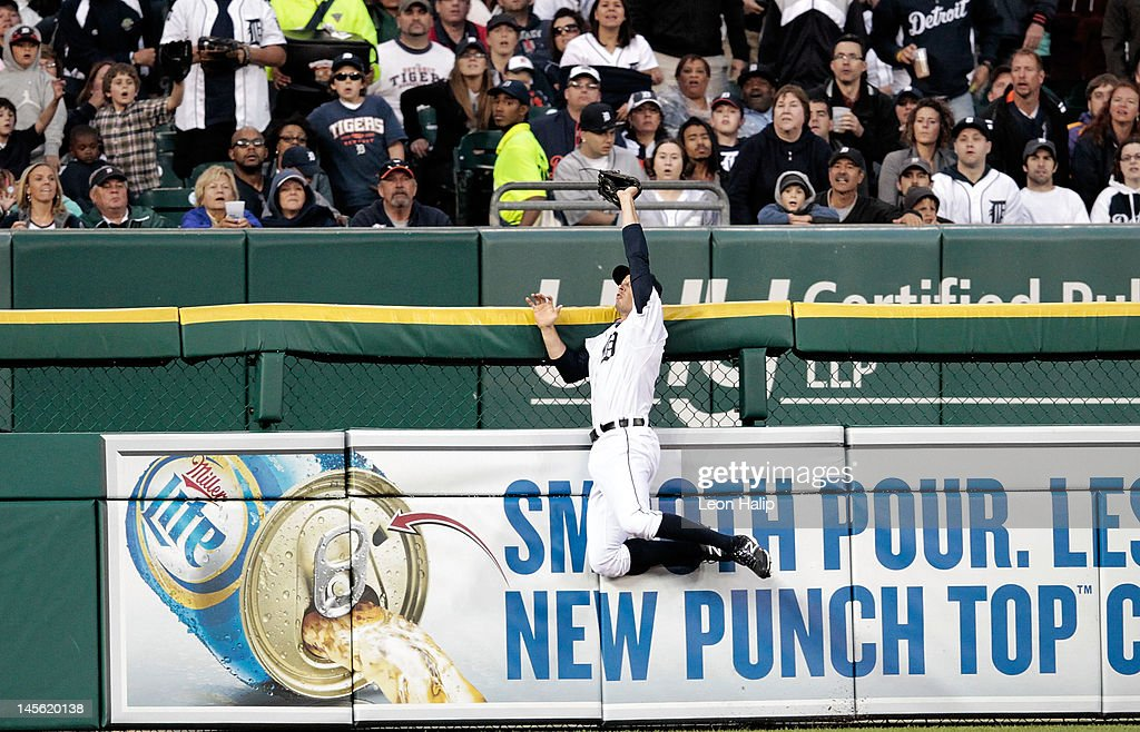 Don Kelly #32 of the Detroit Tigers leaps to take a home run away from Mark Teixeira #25 of the New York Yankees in the fourth inning during the game Comerica Park on June 2, 2012 in Detroit, Michigan.