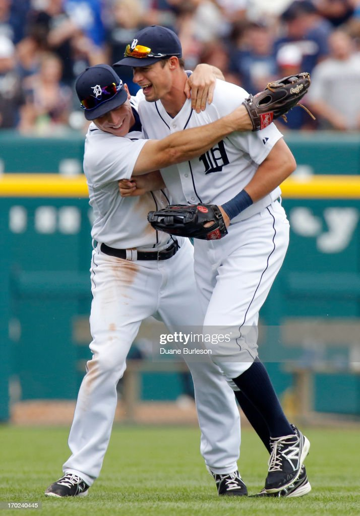 Don Kelly #32 of the Detroit Tigers, right, gets a hug from <a gi-track='captionPersonalityLinkClicked' href=/galleries/search?phrase=Andy+Dirks&family=editorial&specificpeople=7511216 ng-click='$event.stopPropagation()'>Andy Dirks</a> #12 after a 4-1 win over the Cleveland Indians at Comerica Park on June 9, 2013 in Detroit, Michigan. Kelly hit the game-winning, three run, home run in the sixth inning.