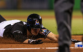 Don Kelly of the Miami Marlins slides safely into third base during the game against the Philadelphia Phillies at Marlins Park on July 27 2016 in...