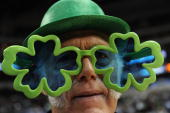 Don Knobler of Dallas Texas wears shamrock glasses in the spirit of St Patrick's day before a game between the Detroit Pistons and the Dallas...