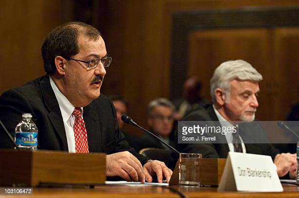 Don L Blankenship chairman and CEO of Massey Energy Co and Cecil Roberts international president of the United Mine Workers of America appear before...