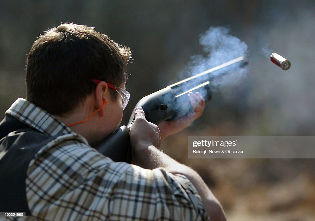 Don Lenfestey of Apex shoots a clay with a semiautomatic shotgun at Deep River Sporting Clays and Shooting School in Sanford North Carolina January...