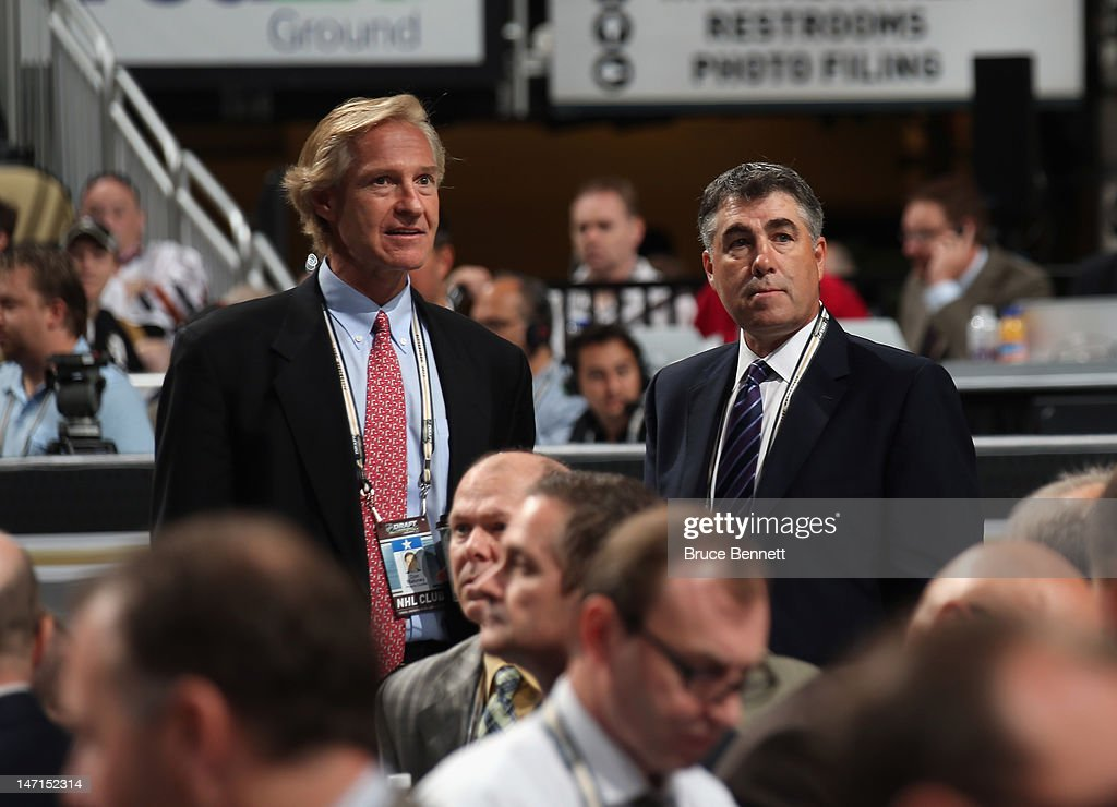 Don Maloney and Dave Tippett of the Phoenix Coyotes discuss matters during Round One of the 2012 NHL Entry Draft at Consol Energy Center on June 22...