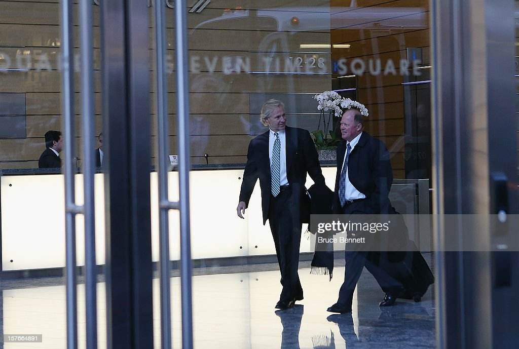 Don Maloney of the Phoenix Coyotes and Bob Murray of the Anaheim Ducks leave the leagues legal offices following the National Hockey League Board of Governors meeting on December 5, 2012 in New York City.