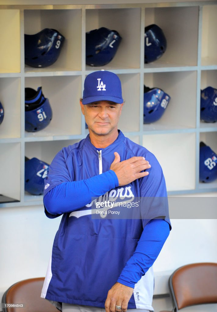<a gi-track='captionPersonalityLinkClicked' href=/galleries/search?phrase=Don+Mattingly&family=editorial&specificpeople=204707 ng-click='$event.stopPropagation()'>Don Mattingly</a> #8 manager of the Los Angeles Dodgers looks on before a baseball game against the San Diego Padres at Petco Park on June 20, 2013 in San Diego, California.