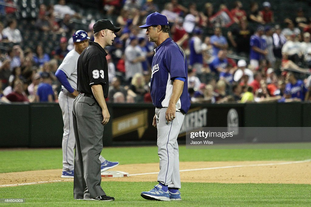 <a gi-track='captionPersonalityLinkClicked' href=/galleries/search?phrase=Don+Mattingly&family=editorial&specificpeople=204707 ng-click='$event.stopPropagation()'>Don Mattingly</a> #8 of the Los Angeles Dodgers argues a double call in the ninth against the Arizona Diamondbacks at Chase Field on April 12, 2014 in Phoenix, Arizona.