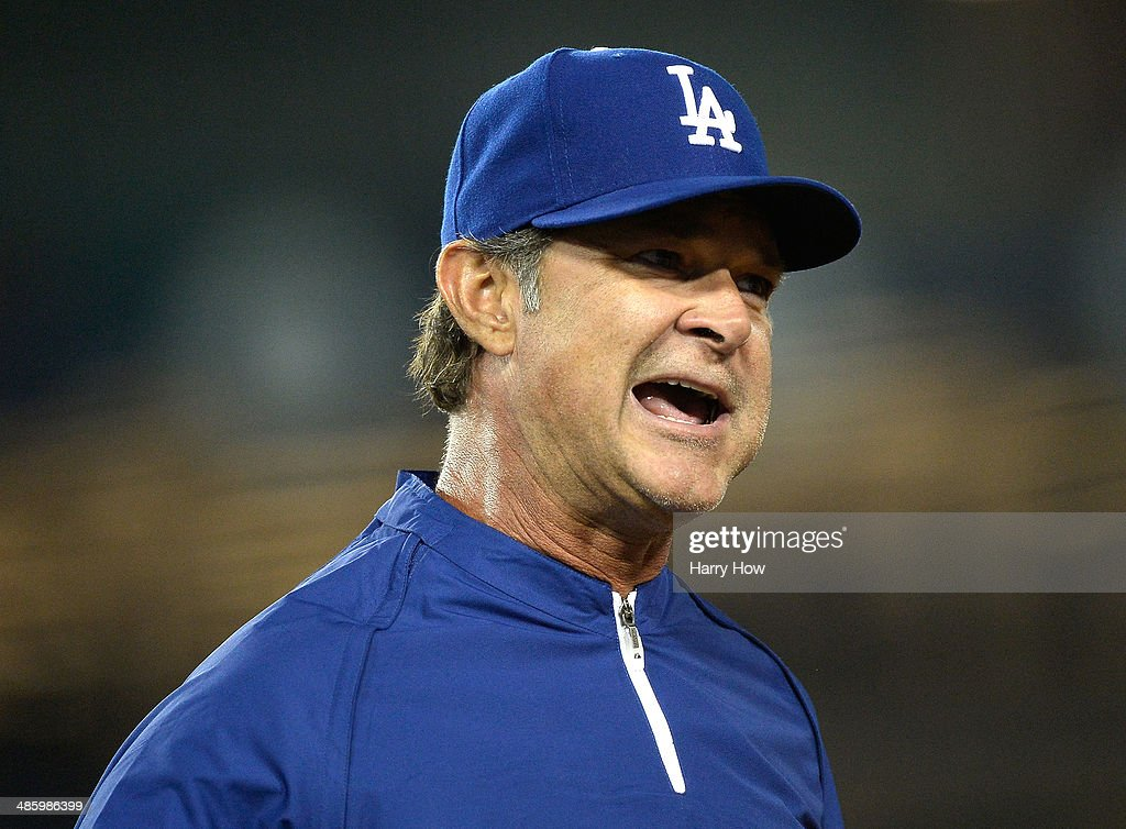 <a gi-track='captionPersonalityLinkClicked' href=/galleries/search?phrase=Don+Mattingly&family=editorial&specificpeople=204707 ng-click='$event.stopPropagation()'>Don Mattingly</a> #8 of the Los Angeles Dodgers questions a call at first base during the fourth inning against the Philadelphia Phillies at Dodger Stadium on April 21, 2014 in Los Angeles, California.