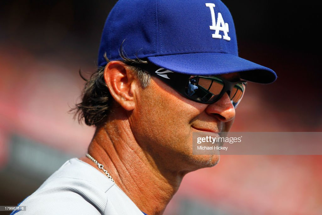 <a gi-track='captionPersonalityLinkClicked' href=/galleries/search?phrase=Don+Mattingly&family=editorial&specificpeople=204707 ng-click='$event.stopPropagation()'>Don Mattingly</a> #8 of the Los Angeles Dodgers watches the game from the dugout against the Cincinnati Reds at Great American Ball Park on September 7, 2013 in Cincinnati, Ohio. Cincinnati defeated Los Angeles 4-3.