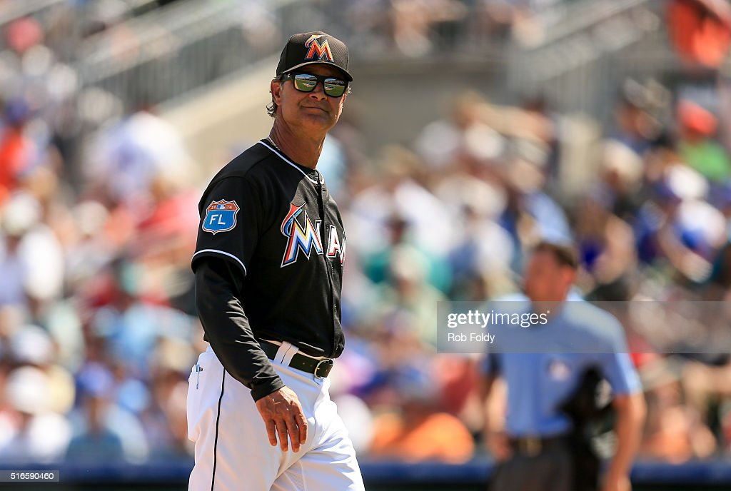 Don Mattingly of the Miami Marlins returns to the dugout during the spring training game against the New York Mets on March 15 2016 in Jupiter Florida