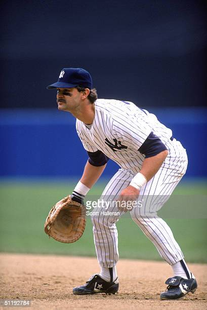 Don Mattingly of the New York Yankees focuses on home plate as he prepares for a play during a 1988 MLB season game at Yankee Stadium in the Bronx...