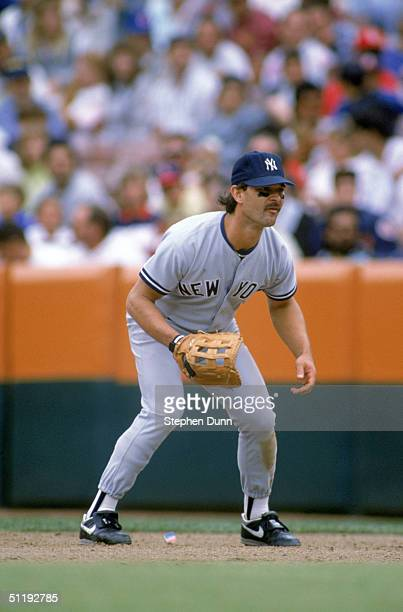 Don Mattingly of the New York Yankees focuses on home plate as he prepares for a play during a 1989 season game against the Anaheim Angels at Angels...