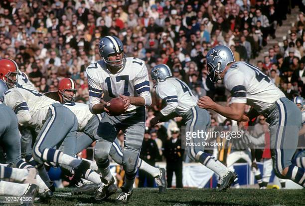 Don Meredith of the Dallas Cowboys turns to hand the ball off to a running back against the Cleveland Browns during an NFL football game at the...