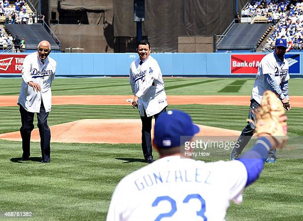 Don Newcombe Fernando Valenzuela and Eric Gagne throw out the opening pitch on opening day before the game between the San Diego Padres and the Los...