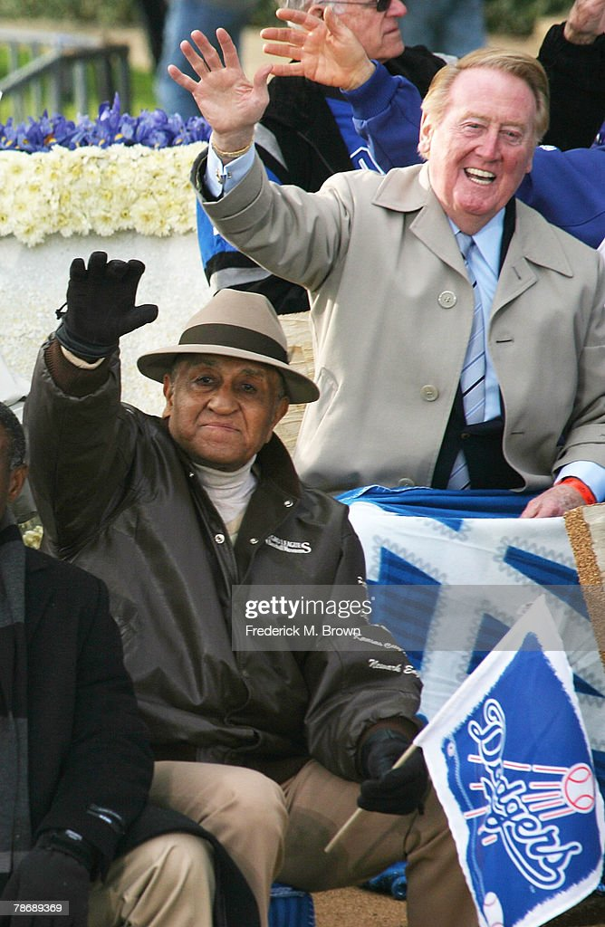 Don Newcombe, former baseball pitcher, and announcer Vince Scully of the Los Angeles Dodgers wave on the parade route during the 2008 Pasadena Tournament of Roses Parade on January 1, 2008 in Pasadena, California.