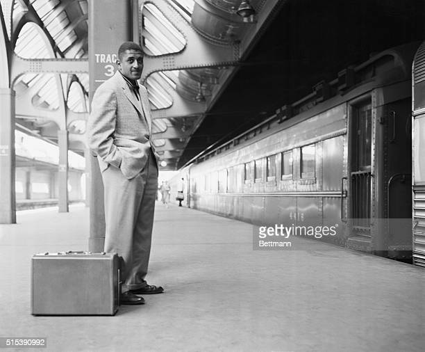Don Newcombe of the Brooklyn Dodgers awaits a train at the Newark Penn Station Newcombe is going to rejoin his teammates in Philadelphia following...
