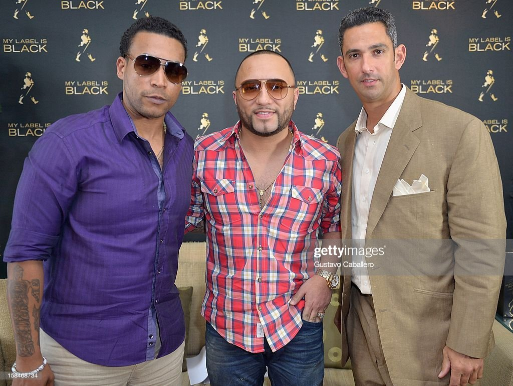 Don Omar, Alex Sensation and Jorge Posada attends the Johnnie Walker My Label Is Black at Mandarin Oriental on December 13, 2012 in Miami, Florida.
