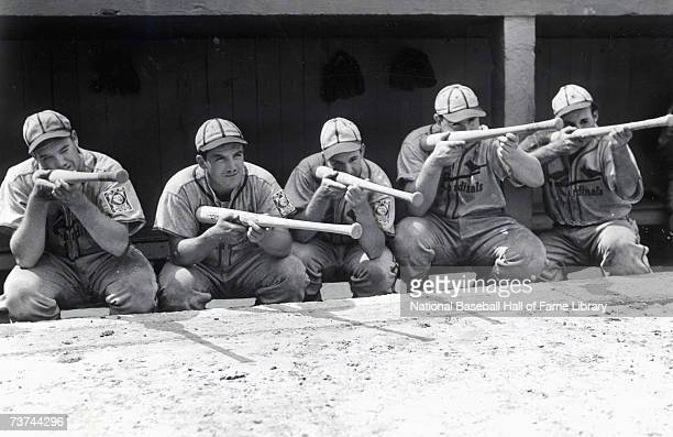 Don Padgett Joe Medwick Enos Slaughter Johnny Mize and Pepper Martin of 1940 St Louis Cardinals play in the dugout