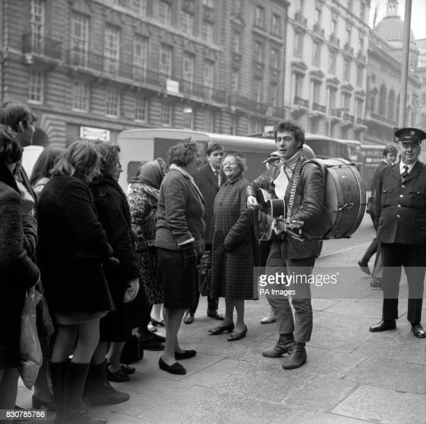 Don Partridge the man who gave up many jobs to become a London busker seen entertaining outside the Paris Studio Lower Regent Street London...