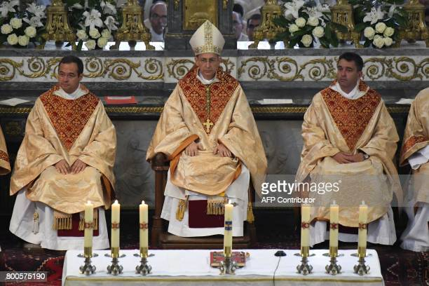 Don Paul Préaux Laval's bishop Thierry Scherrer and Don LouisHervé Guiny attend an ordination Mass at Notre Dame de l'épine basilica in Evron on June...