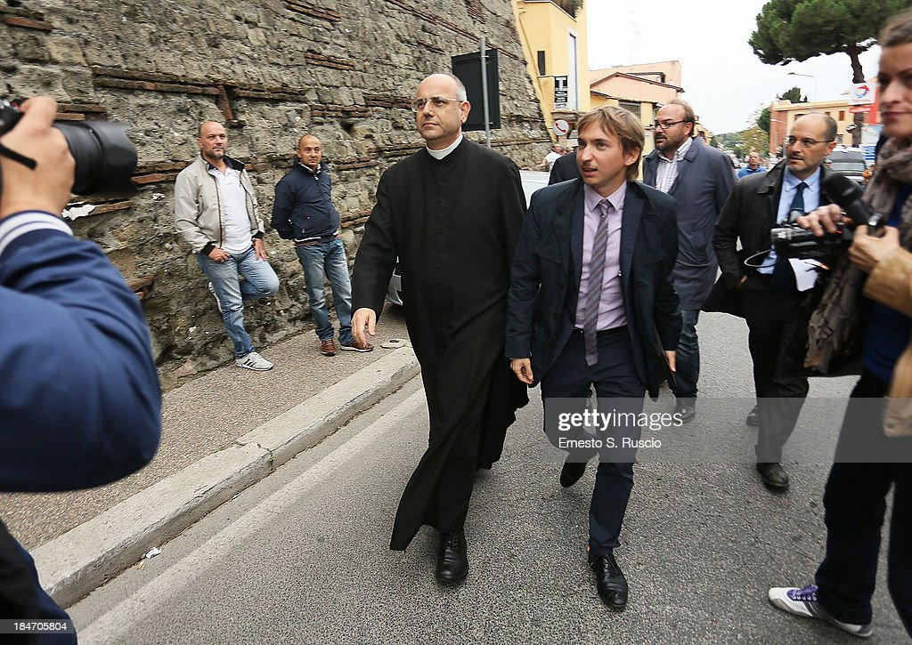 Don Pierpaolo Petrucci walks during the demonstration at funeral location of Nazi War Criminal Erich Priebke on October 15, 2013 in Albano Laziale, Italy. The funeral of Erich Priebke, a former SS officer convicted of participating in the massacre of 335 citizens in Italy during World War II will now take place at the Lefebvriani Chapel in Albano Laziale, after the Catholic Church announced in a statement soon after his death that 'no public funeral would be granted to him in the city or outskirts of Rome'. His burial is not yet settled after his German hometown refused to allow his burial there.