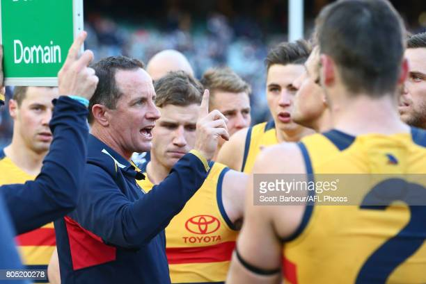 Don Pyke coach of the Crows speaks to his team during a quarter time break during the round 15 AFL match between the Carlton Blues and the Adelaide...