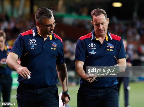 Don Pyke Senior Coach of the Crows chats to Scott Camporeale Assistant Coach of the Crows during the 2017 AFL First Preliminary Final match between...