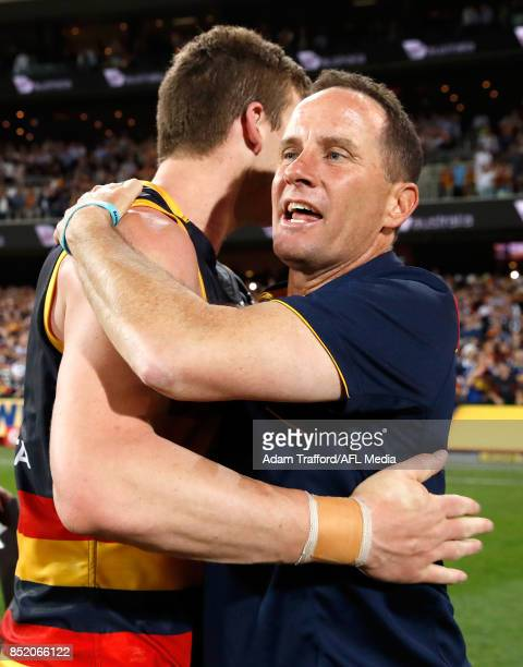 Don Pyke Senior Coach of the Crows hugs Josh Jenkins of the Crows during the 2017 AFL First Preliminary Final match between the Adelaide Crows and...
