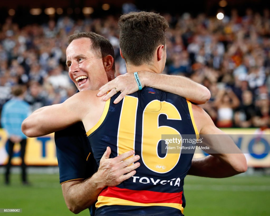 Don Pyke, Senior Coach of the Crows hugs Luke Brown of the Crows during the 2017 AFL First Preliminary Final match between the Adelaide Crows and the Geelong Cats at Adelaide Oval on September 22, 2017 in Adelaide, Australia.