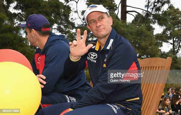 Don Pyke the coach of the Crows waves to the crowd during the 2017 AFL Grand Final Parade on September 29 2017 in Melbourne Australia