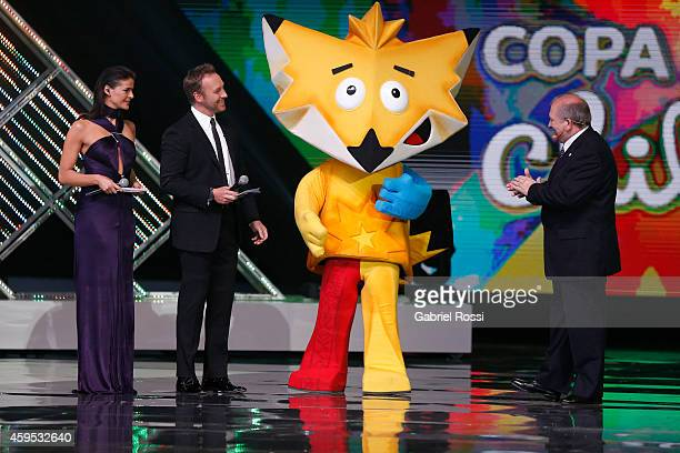 Don Rene Rosas Executive Director of Copa America 2015 enters the stage with the Official tournament Mascot during the Official Draw of Copa America...