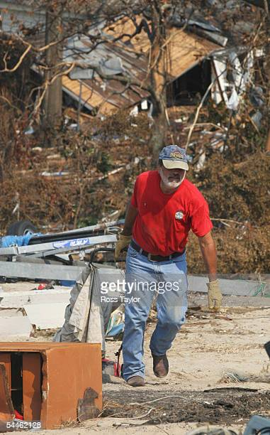 Don Schwartz an employee of Lighthouse Pawn Shop works to clear the area where the shop used to be September 3 2005 in Biloxi Mississippi Thousands...