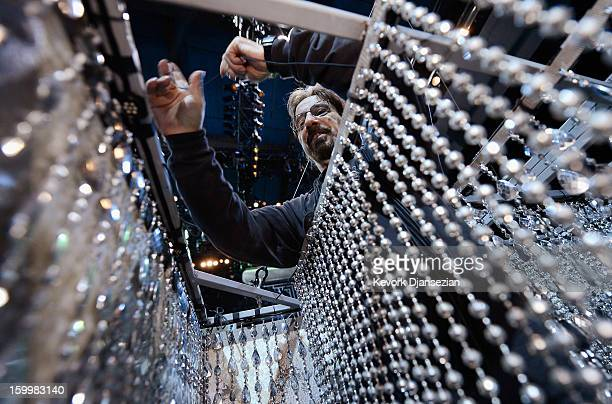 Don Smith set up the chandeliers during the 19th Annual Screen Actor Guild Awards ceremony behind the scenes event at The Shrine Auditorium on...