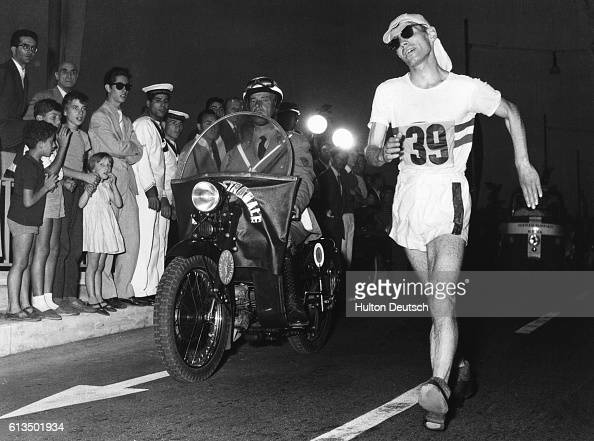Don Thompson wins the Olympic gold medal for the 50 kilometer road walk The smallest man in the field Thompson from Cranford Middlesex strode home 17...