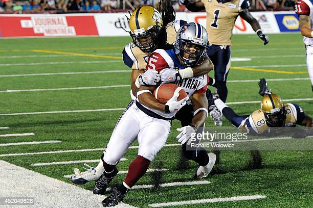 Don Unamba of the Winnipeg Blue Bombers tackles Larry Taylor of the Montreal Alouettes during the CFL game at Percival Molson Stadium on December 31...