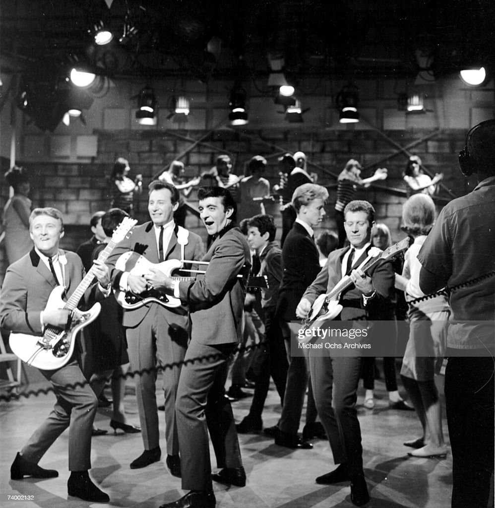 Don Wilson Mel Taylor Nokie Edwards and Bob Bogle of the rock and roll band 'The Ventures' perform onstage on the TV show American Bandstand with...