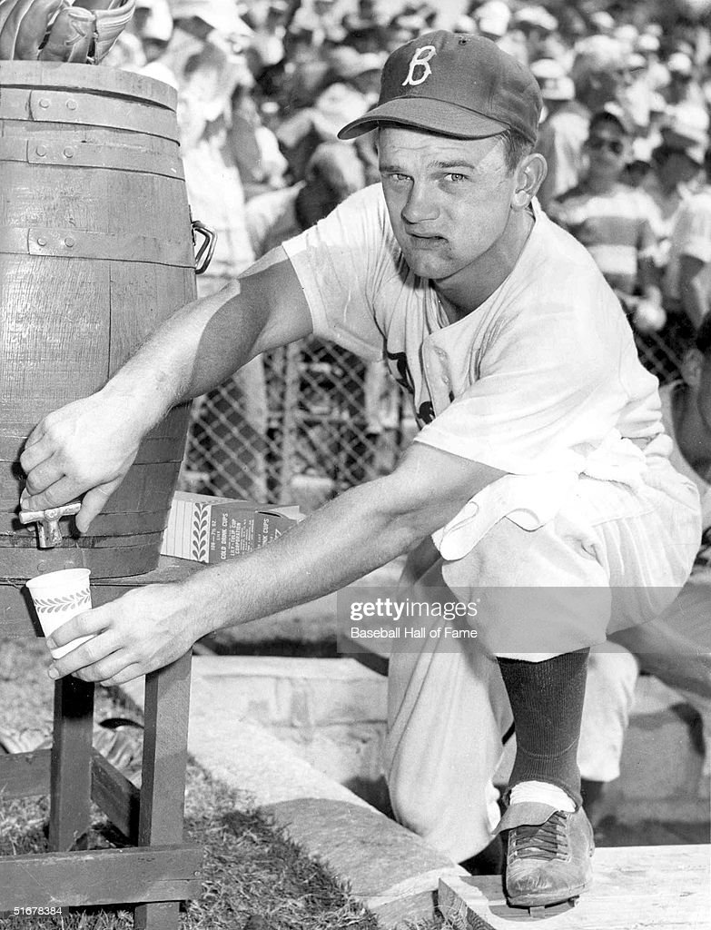 <a gi-track='captionPersonalityLinkClicked' href=/galleries/search?phrase=Don+Zimmer&family=editorial&specificpeople=215376 ng-click='$event.stopPropagation()'>Don Zimmer</a> #23 of the Brooklyn Dodgers gets a drink circa mid-1950s. He played with the Dodgers from 1954-59 and again in 1963.