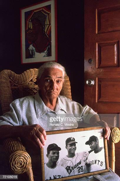 Dona Virginia Alou holding photo of her sons Matty Felipe and Jesus Alou in January 1995 in Santo Domingo Dominican Republic