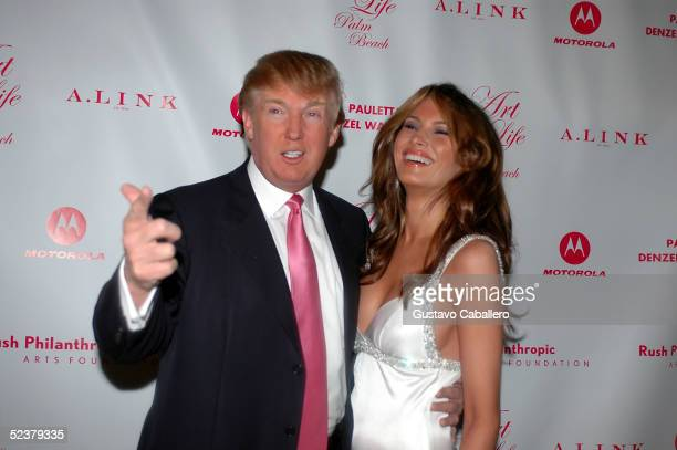 Donald and Melania Trump at Russell Simmons 'Art For Life Palm Beach' Honoring Sean 'P Diddy' Combs at MaraLago on March 11 2005 in Palm Beach Florida