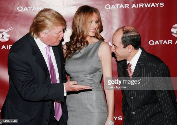 Donald and Melania Trump chat with Qatar Airways CEO Akbar Al Baker at a Qatar Airways gala to celebrate their inaugural flights to NYC June 28 2007...
