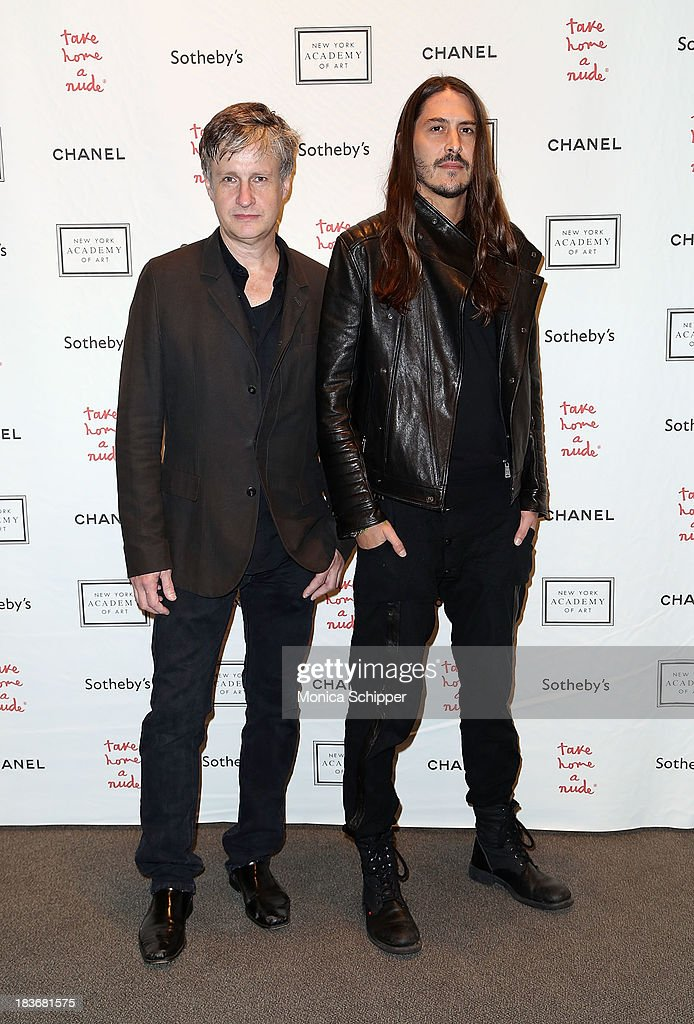 Donald Baechler and Kevin Baker attend 2013 'Take Home A Nude' Benefit Art Auction And Party at Sotheby's on October 8, 2013 in New York City.