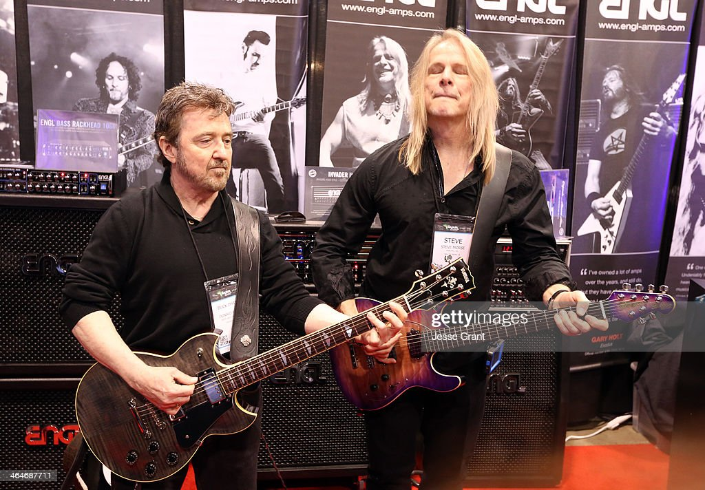 Donald Brian 'Buck Dharma' Roeser and Steve Morse attend the 2014 National Association of Music Merchants show at the Anaheim Convention Center on January 23, 2014 in Anaheim, California.
